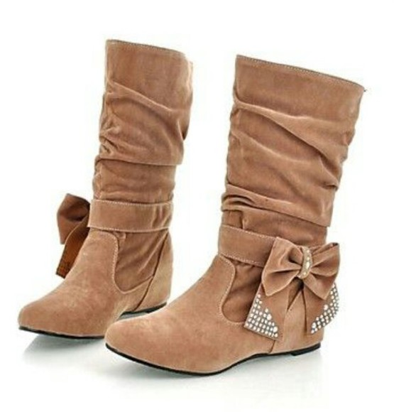 studs tan boots bows