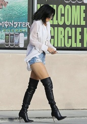 kylie jenner,black,black boots,knee high boots,boots,leather boots,louboutin,kardashians,shoes,fall outfits,blouse,ripped shorts