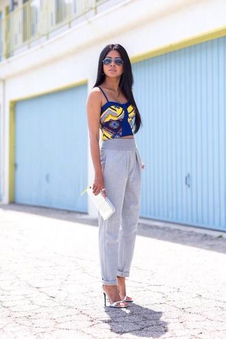 pants blue pants sunglasses gray blue skinny jeans yellow top white handbag sweatpants asap rocky street fashion
