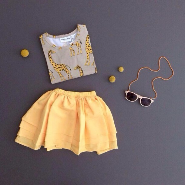 skirt yellow top sunglasses giraffe