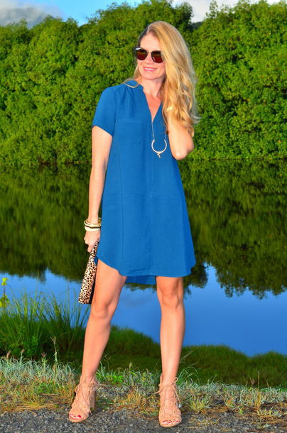thelifeoftheparty blogger dress jewels sunglasses shoes bag blue dress sandals clutch