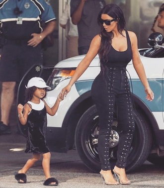 jeans kim kardashian black pants lace up pants kardashians keeping up with the kardashians kim kardashian style black lace up celebrity celebrity style celebstyle for less north west