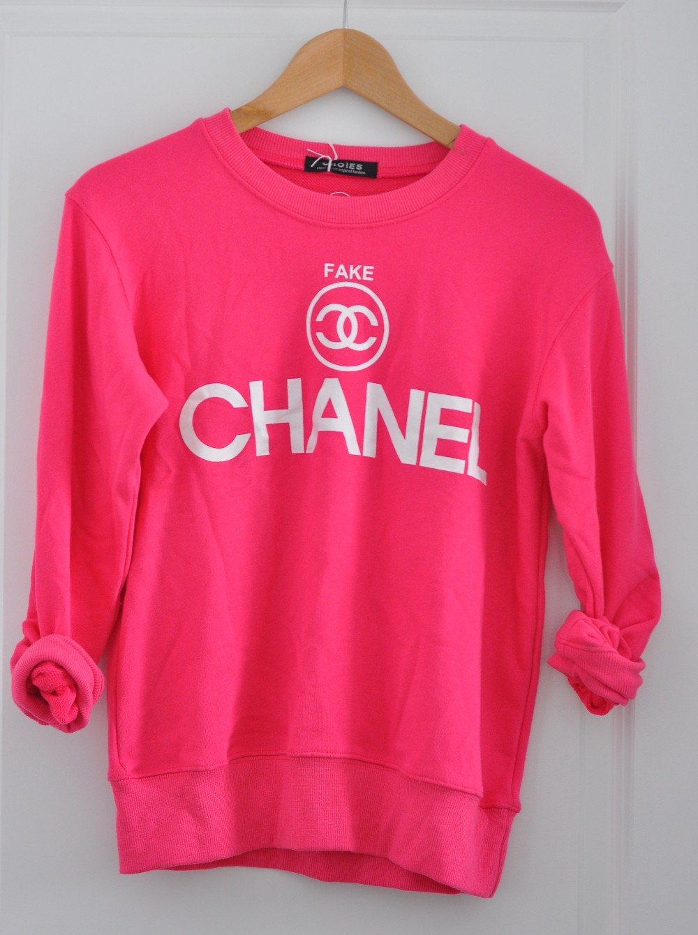 Hot pink fake chanel sweater by dogsanddresses