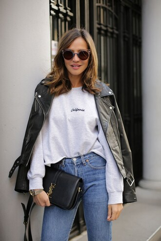 lady addict blogger sunglasses jewels california round sunglasses grey sweater biker jacket leather jacket yves saint laurent mom jeans sports sweater sweater