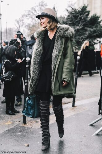 coat tumblr green coat fur collar coat winter outfits winter coat fashion week 2017 streetstyle sweater black sweater v neck skirt mini skirt black skirt tights opaque tights boots black boots high heels boots over the knee boots bag blue bag hat