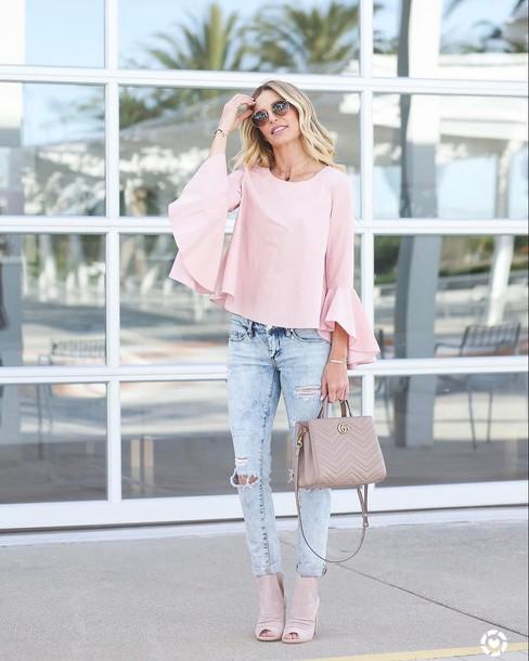 blouse tumblr pink blouse bell sleeves pink top denim jeans light blue jeans ripped jeans bag pink bag high heels heels peep toe heels sunglasses spring outfits