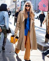 bag,handbag,leather bag,wide-leg pants,shirt,oversized coat,jacket,sunglasses