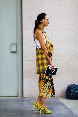 top fashion week street style fashion week 2016 fashion week milan fashion week 2016 yellow top tartan plaid skirt floral skirt midi skirt shoes pumps yellow shoes high heel pumps streetstyle one shoulder