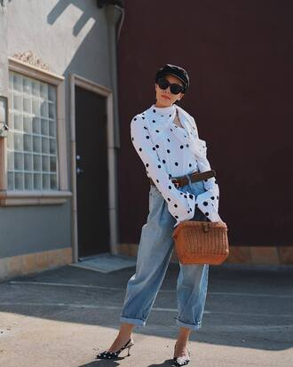 top white top polka dots denim jeans blue jeans cuffed jeans bag basket bag shoes slingbacks sunglasses hat