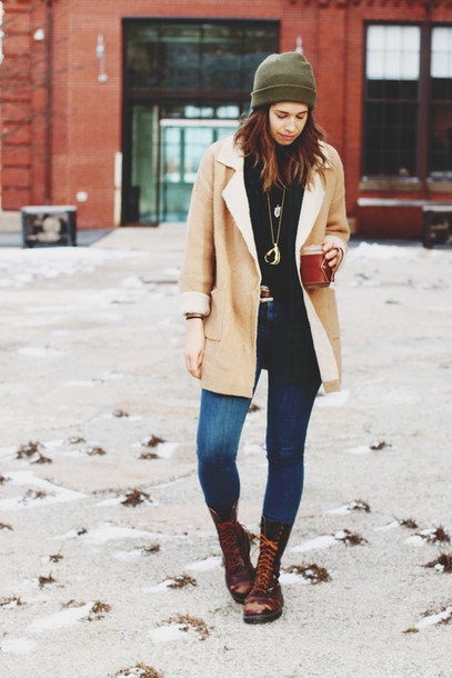 orchid grey blogger combat boots shearling jacket skinny jeans brown shearling jacket blue jeans beanie green beanie camel coat winter outfits winter coat brown boots boots flat boots black top necklace camel shearling coat