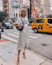 skirt,asymmetrical skirt,polka dots,wrap skirt,wrap ruffle skirt,high heel sandals,versace,white t-shirt,belt bag,necklace,earrings