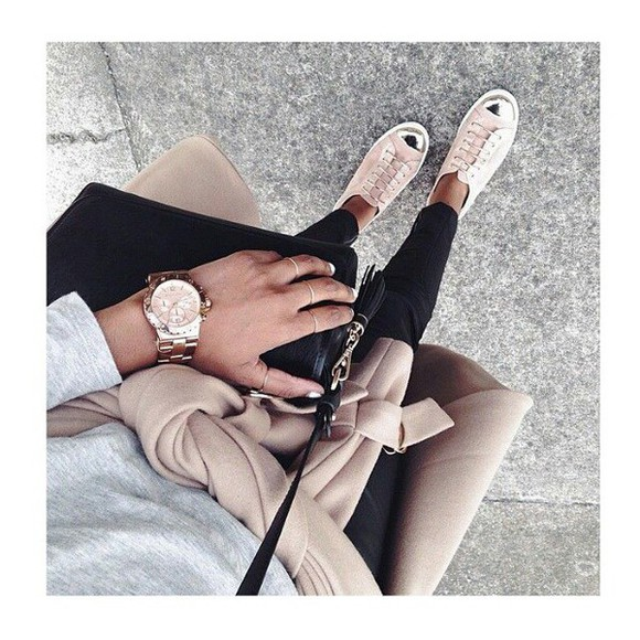 gold watch black purse sneakers beige coat grey