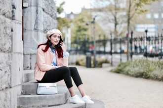 preppy fashionist blogger sweater blouse coat pants bag jewels pink jacket sneakers beret leggings spring outfits