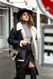 black leather skirt,the fashion fraction,leather,blogger,belt,black shearling jacket,thigh high boots,animal print bag,black hat,front slit skirt,striped sweater,winter outfits,leather skirt,striped turtleneck,striped turtleneck sweater