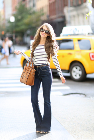 southern curls and pearls blogger striped top flare jeans celine bag orange bag kick flare jeans striped off shoulder top stripes top long sleeves brown bag sunglasses tortoise shell tortoise shell sunglasses 70s style jeans blue jeans belt spring outfits animal print high heels
