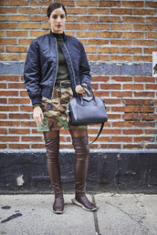 shoes,nyfw 2017,fashion week 2017,fashion week,streetstyle,skirt,mini skirt,camouflage,top,green,turtleneck,bag,black bag,jacket,black jacket,bomber jacket,black bomber jacket,brown boots