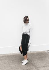 modern legacy,blogger,sweater,skirt,shoes,bag,sunglasses,knitted skirt,wrap skirt,asymmetrical,asymmetrical skirt,midi skirt,black skirt,fringe sweater