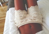 shorts,lace,white,clothes,white lace shorts,lace shorts,shirt,pants,white shorts,wish.com,floral,lace up,jewels,style,fashion,beautiful,cropped