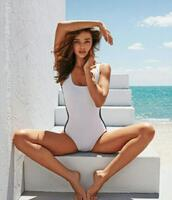 swimwear,vintage,black and white,summer,one piece swimsuit,miranda kerr,beach,editorial