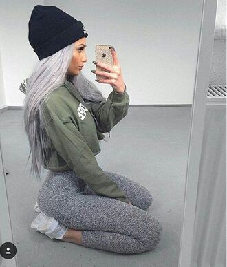 shirt outfit leggings green sweater top cropped hoodie sweater cropped sweater black beanie beanie grey leggings grey pants white sneakers