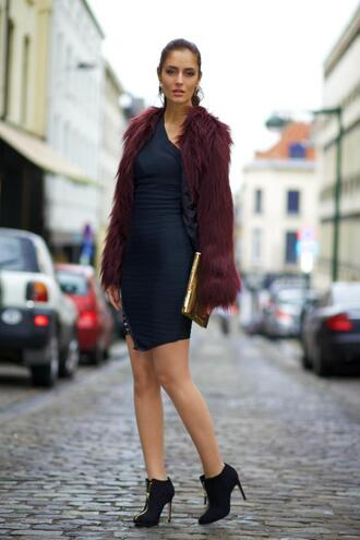 from brussels with love blogger faux fur jacket burgundy navy bodycon dress one shoulder dress shoes coat jewels bag