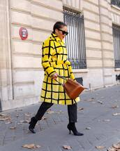 coat,yellow coat,high waisted black jeans,black boots,heel boots,brown bag,black sunglasses