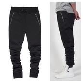 pants,black sweatpants,zip,slim fitting,cotton,spandex,zipper pockets,menswear,zipped pants