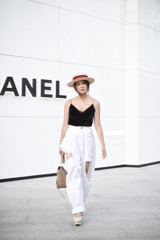 brown platform blogger tank top jeans hat belt bag shoes white pants black top