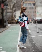 top,sweatshirt,printed top,white boots,sunglasses,jeans,denim,blue jeans,boots