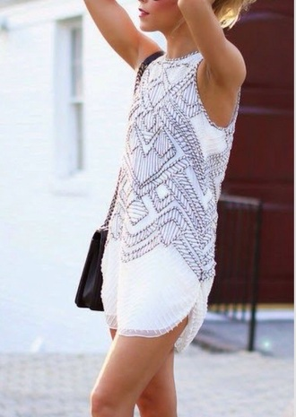 white dress summer dress prom dress short dress sleeveless dress tribal pattern white sheer mini dress black bag shoulder bag black heels strappy heels