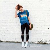 t-shirt,army green bag,colorado,blue tee,converse,messy bun,brick wall,black distressed jeans,black jeans,ripped jeans,oversized,clear aviators