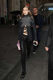 blouse,top,all black everything,streetwear,streetstyle,model off-duty,gigi hadid,pants,lace up,fall outfits