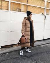 bag,brown bag,puffer jacket,white sneakers,black hat,black blouse,black pants