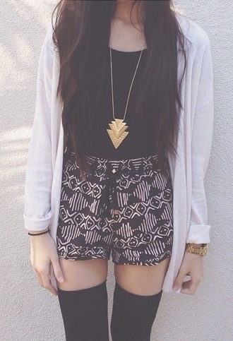 jewels gold shirt sweater underwear necklace triangle cardigan shorts pattern summer blouse cute short tumblr shorts chevron tribal pattern bohemian high waisted shorts vanessa hudgens black and white black shorts black aztec flowy spring dress tie at waist motifs high waist shorts aztec stylish trendy