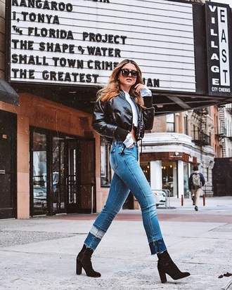 jacket cropped jacket black jacket bomber jacket crop tops white t-shirt jeans blue jeans boots black boots sunglasses
