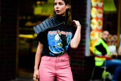 t-shirt,fashion week street style,fashion week 2016,london fashion week 2016,fashion week,streetstyle,black t-shirt,iron maiden,graphic tee,pants,pink pants