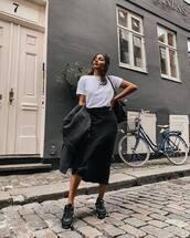 skirt,midi skirt,black skirt,silk,sneakers,white t-shirt,shoulder bag,coat