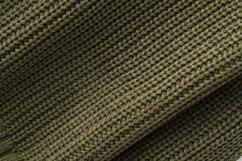 Dark green knit sweater with raglan sleeve