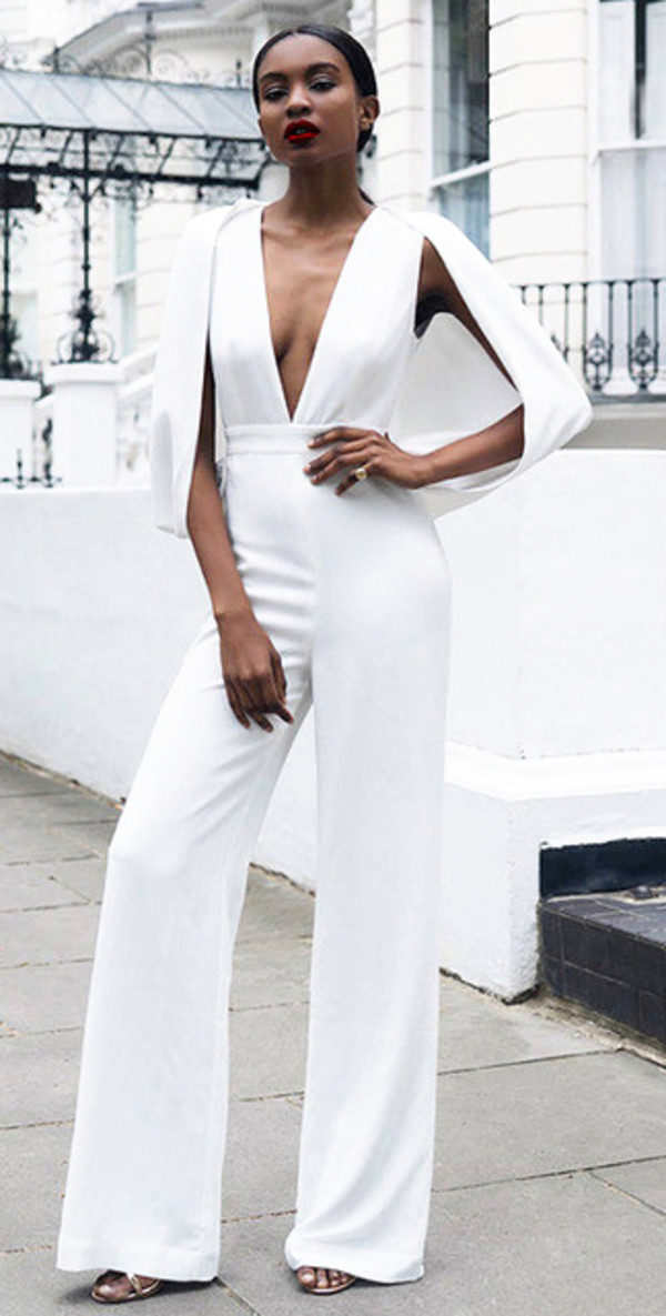 jumpsuit dream it wear it white jumpsuit jumpsuit summer summer outfits classy elegant cute girly summer holidays celebrity style celebstyle for less celebrity celebrities in white romantic romantic outfits clubwear sexy sexy outfit pretty dope plunge v neck plunge dress cape sleeves cape sleeve jumpsuit wide-leg pants