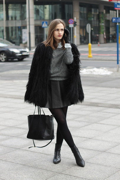so in carmel blogger leather skirt grey sweater black bag black boots fluffy winter outfits