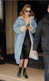denim jacket,coat,black dress,gigi hadid,fashion week 2016,paris fashion week 2016,bralette,blue coat,jean jackets,denim,long coat,long sleeves,slip dress,winter coat,black slip dress,blue long coat