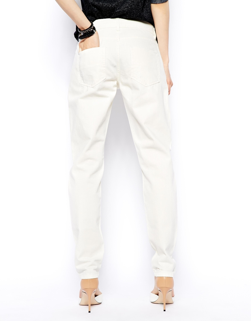 ASOS Brady Low Rise Slim Boyfriend Jeans in Milk Wash with Rips at asos.com