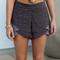Marianela black printed ruffle hem shorts