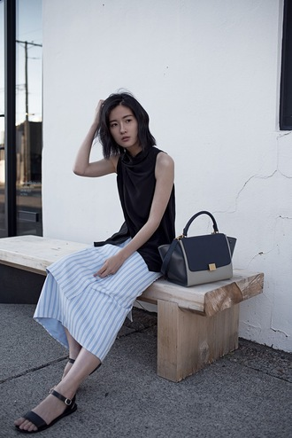 von vogue blogger striped skirt minimalist leather bag black top draped top celine bag