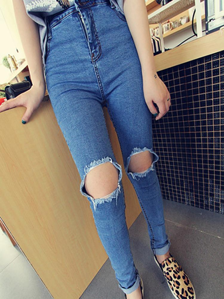 High waist ultra skinny jeans with busted knees