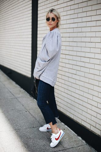top grey top tumblr sweatshirt denim jeans blue jeans puffed sleeves sneakers white sneakers nike nike shoes sunglasses shoes