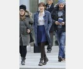 coat,fifty shades of grey,dakota johnson,duffle coat,blue skirt,floral shirt,black boots