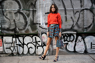 man repeller blogger printed skirt fall outfits knitted sweater cable knit