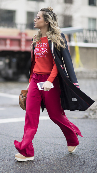 pants nyfw 2017 fashion week 2017 fashion week streetstyle pink pants sweater red sweater coat black coat bag basket bag shoes 00s style