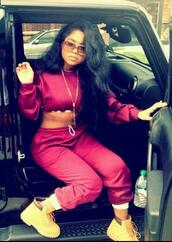 pants,red sweatpants,sweater,shoes,jewels,sunglasses,shirt,celebrity style,sweatpants,joggers,crop tops,jumpsuit,urban,pretty woman,timberlands,wavy hair,top,burgundy crop top,burgundy sweatpants,sweatsuit set,sweats,cropped,athletic,burgundy,burgundy sweater,timbs and crop top